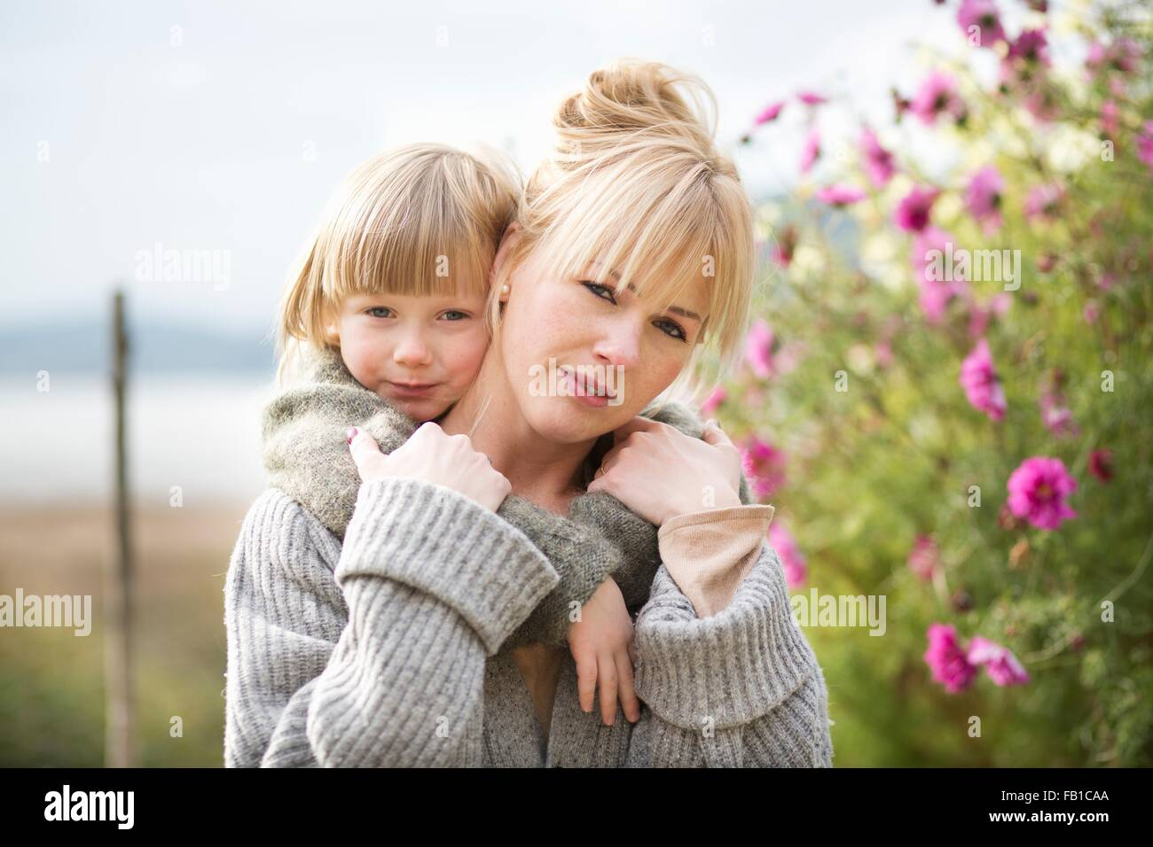 Portrait of boy and mother in organic garden - Stock Image