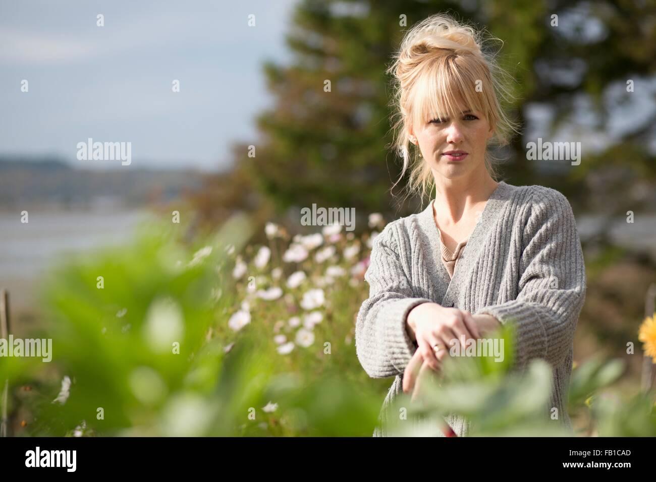 Portrait of woman in organic garden, Orust, Sweden - Stock Image