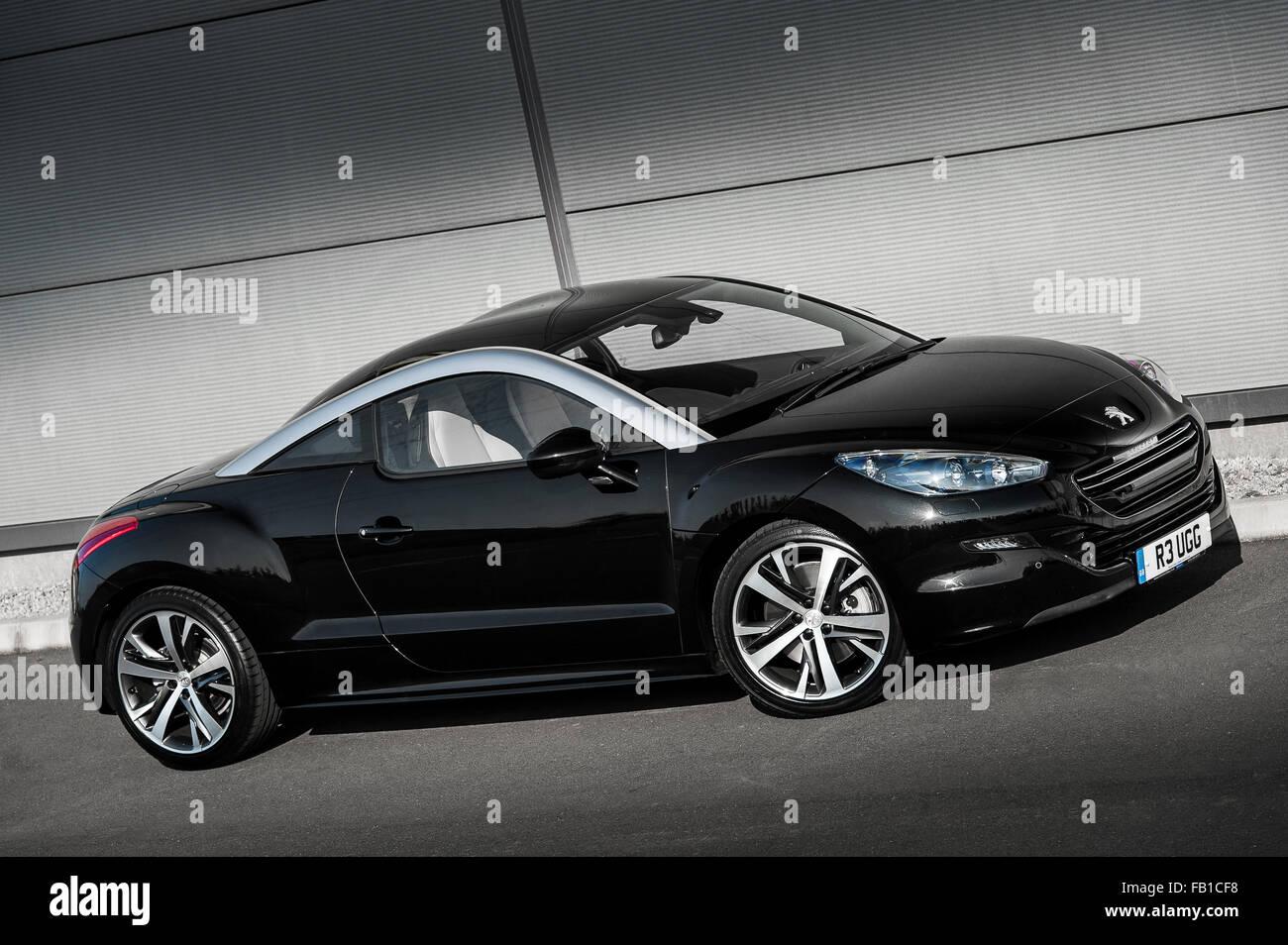 Black Peugeot RCZ Coupe sports car. - Stock Image