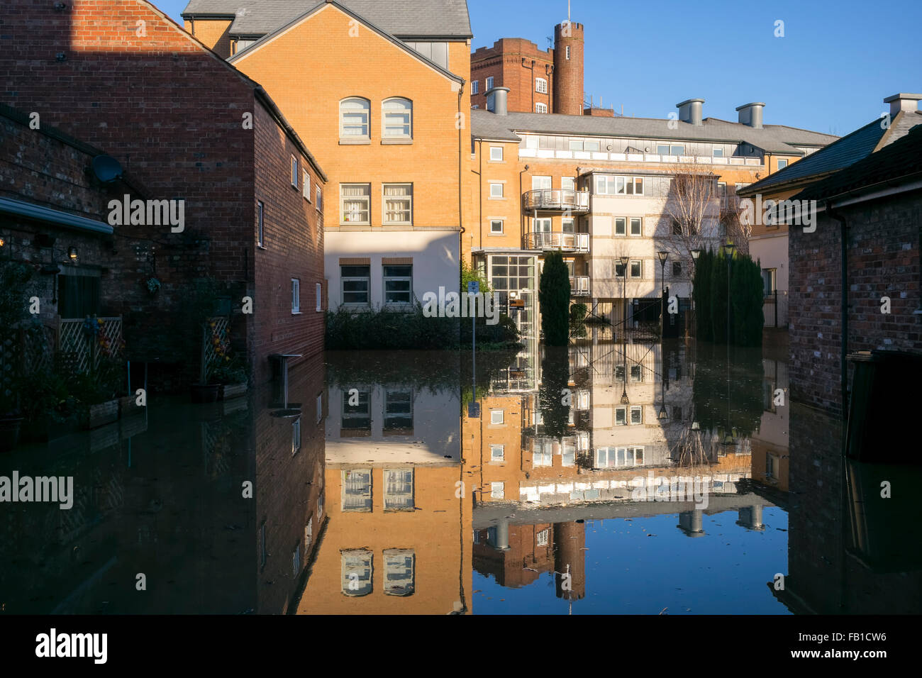 'Leetham's flour mill' reflected in Dixon's Yard following the flooding of the River Foss, Christmas 2015, York, Stock Photo