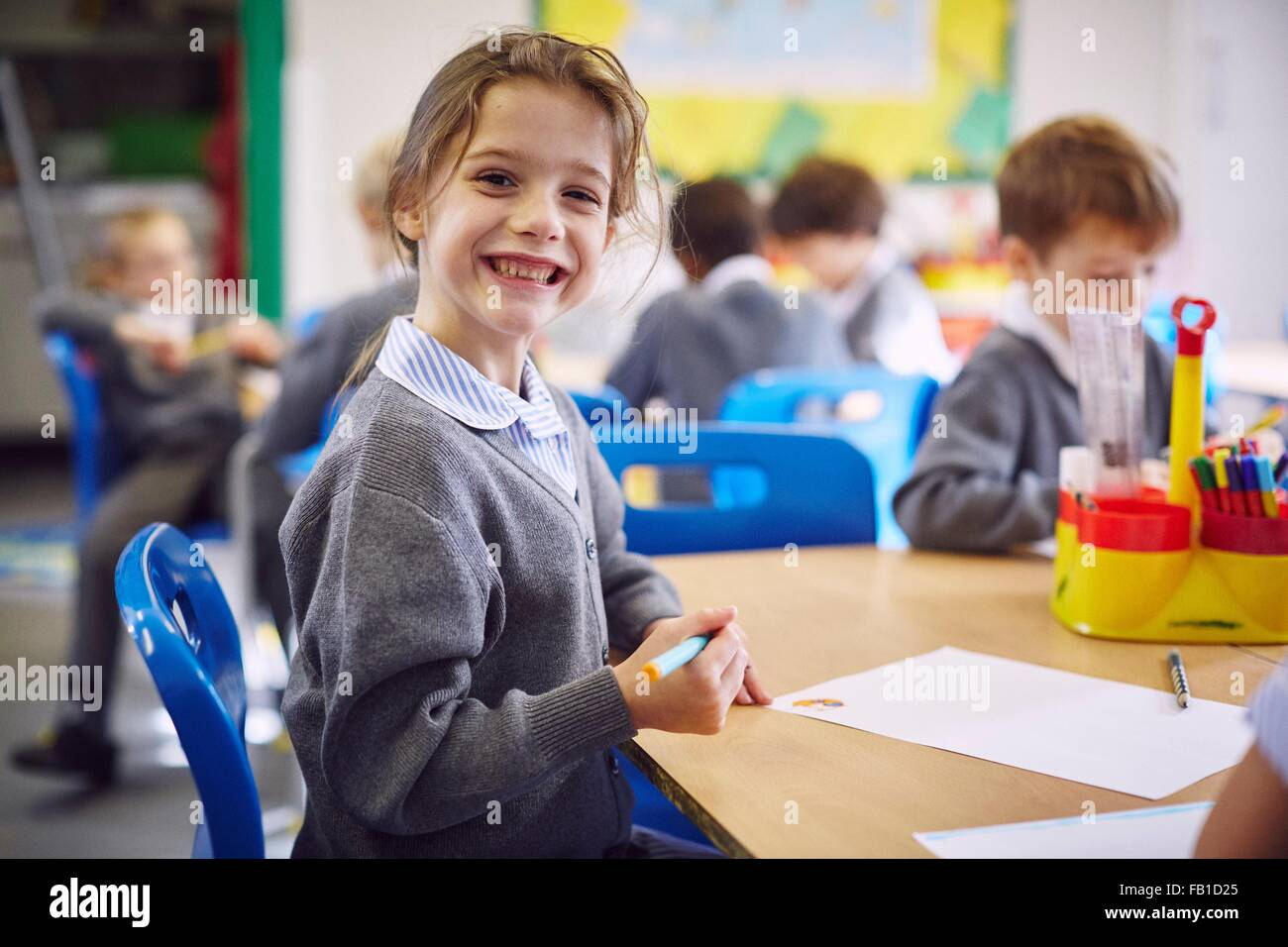 Portrait of girl at desk in elementary school - Stock Image