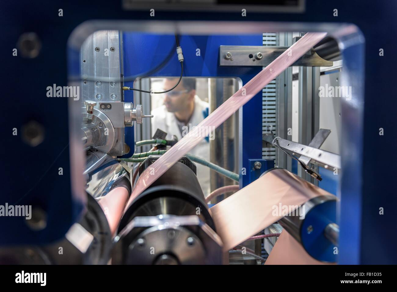 Manufacturing lithium ion batteries in battery research facility - Stock Image