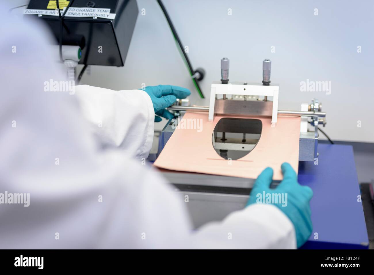 Battery Lab Stock Photos Images Alamy Integrated Circuitvintage Scientist Making Lithium Ion Samples In Research Facility Close Up Image