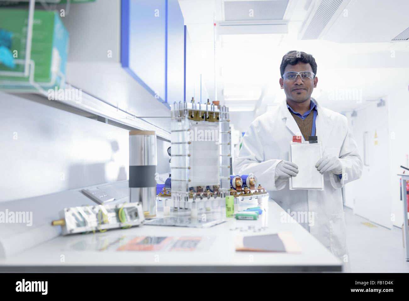 Portrait of scientist assembling lithium ion battery samples in battery research facility Stock Photo
