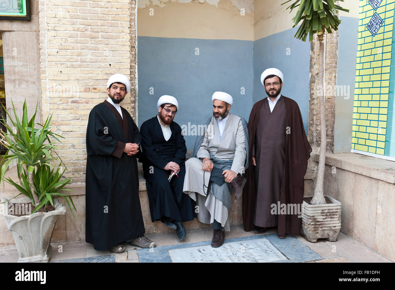 Four mullahs with turbans and long robes, Shiite clerics, Ali Ebn Mosque Imamzadeh-ye-e Hamze or Ali ibn Ahmad ibn - Stock Image