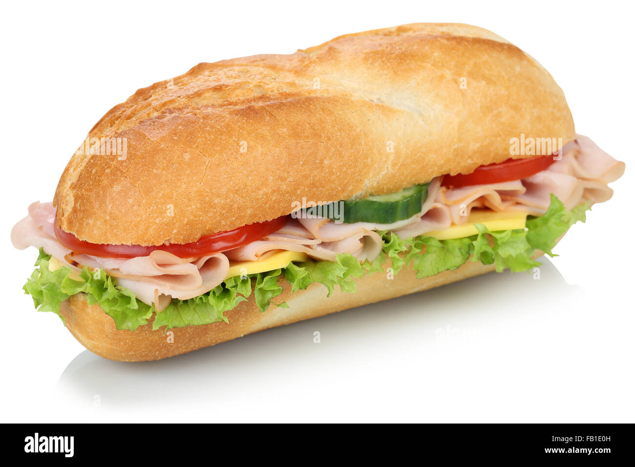 Sub deli sandwich baguette with ham, cheese, tomatoes and lettuce isolated on a white background - Stock Image