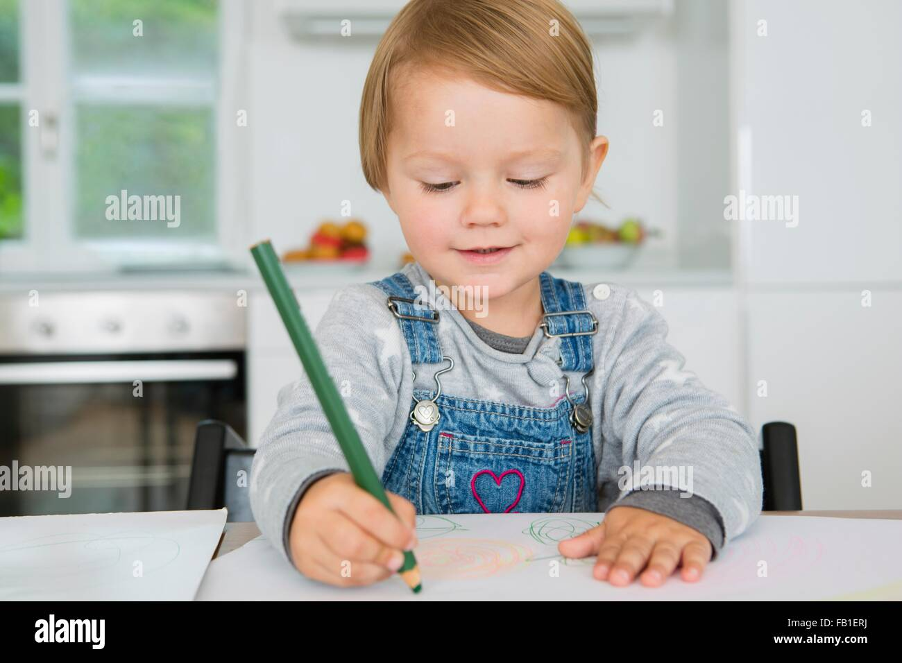 Female Toddler Drawing Kitchen Table Stock Photos & Female Toddler ...