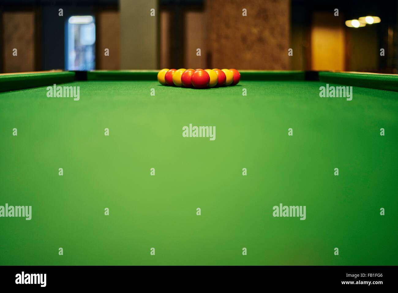 Surface Level View Of Yellow And Red Pool Balls On Pool Table Stock - How to level a pool table