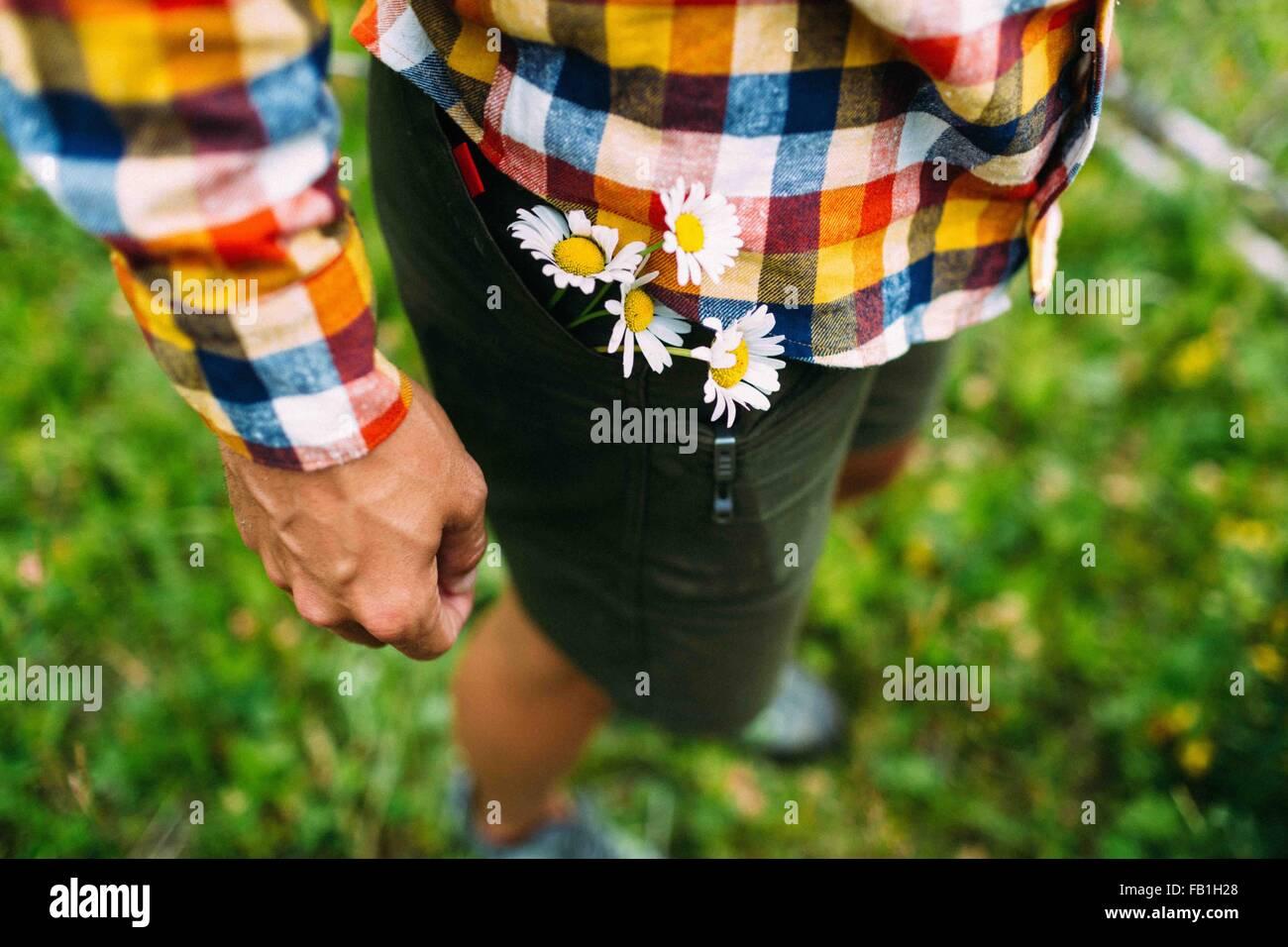High angle view mid adult man wearing checked shirt daisies shorts pocket Moraine lake Banff National Park Alberta - Stock Image