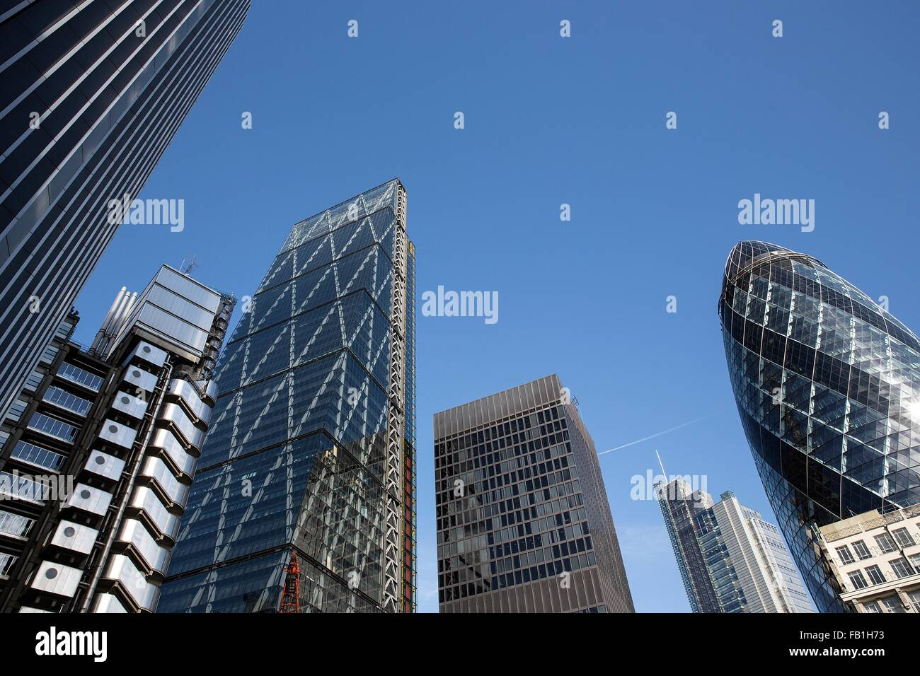 Low angle view of the Gherkin, Lloyds Building and the Cheesegrater, London, UK - Stock Image
