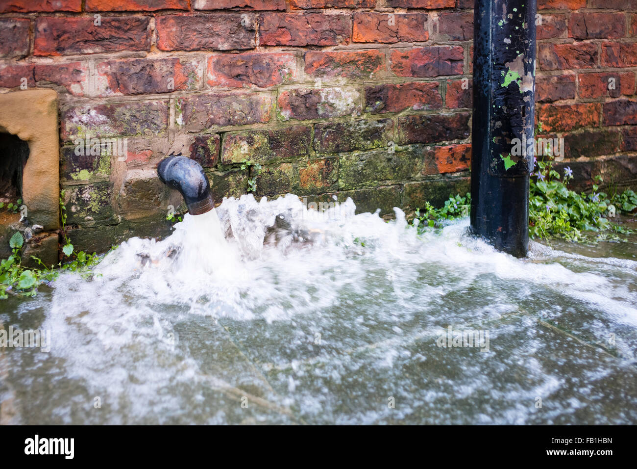 Floodwater from the River Ouse being pumped from a cellar in Peckitt Street, Christmas 2015, York, Yorkshire, England - Stock Image