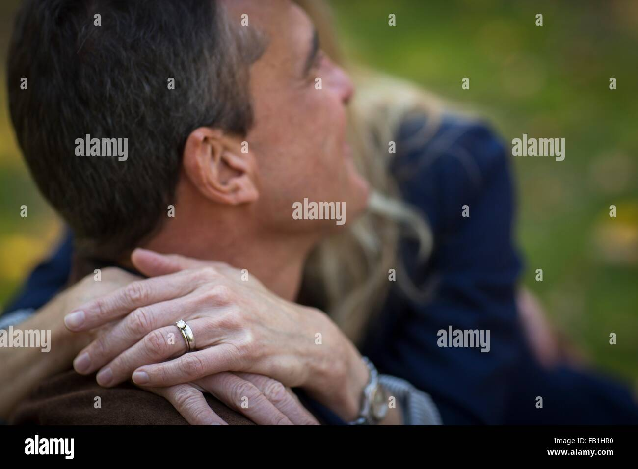 Close up of romantic mature couple in garden Stock Photo
