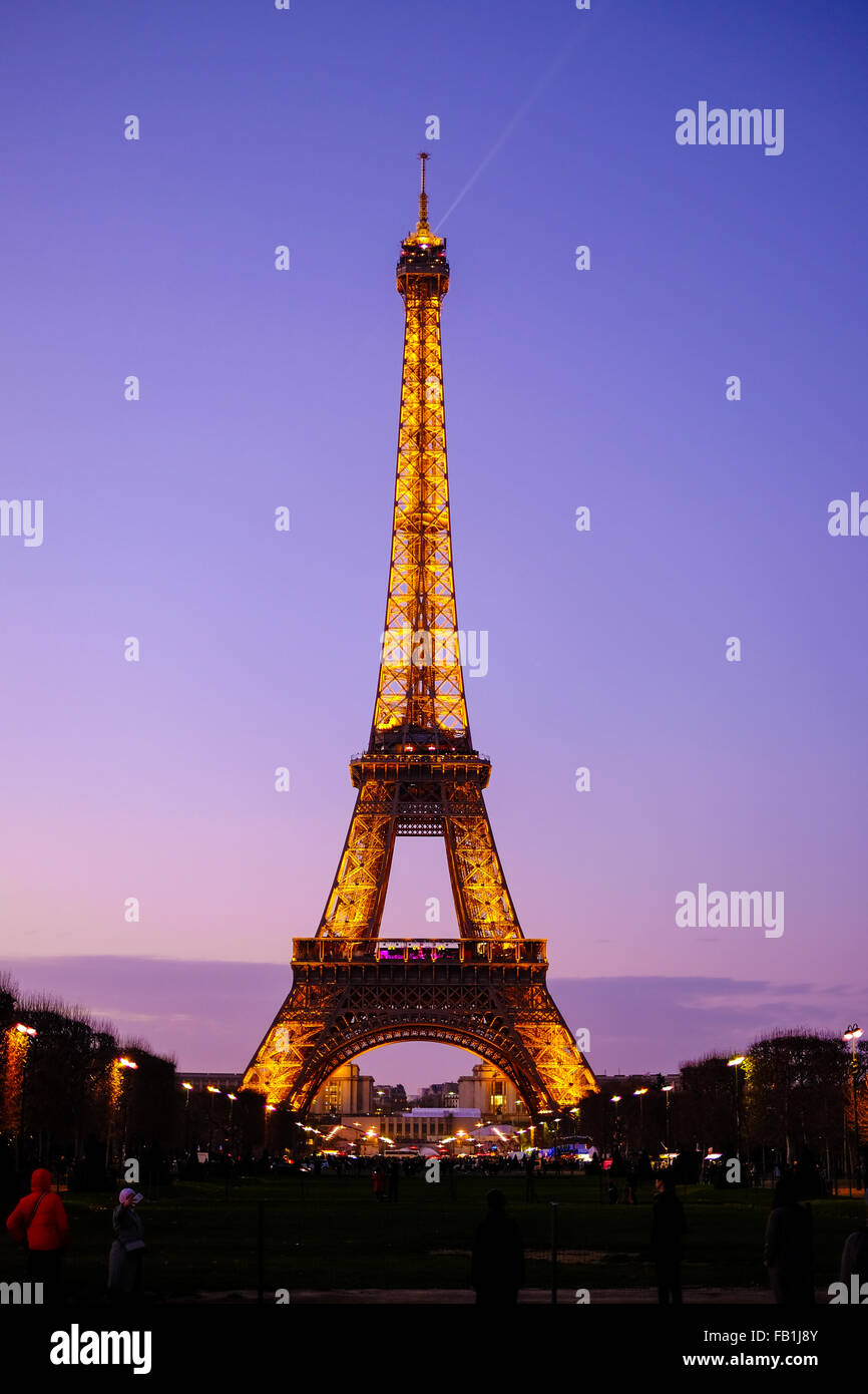 Eiffel Tower at Sunset in Paris, France just after the lights come on. Stock Photo