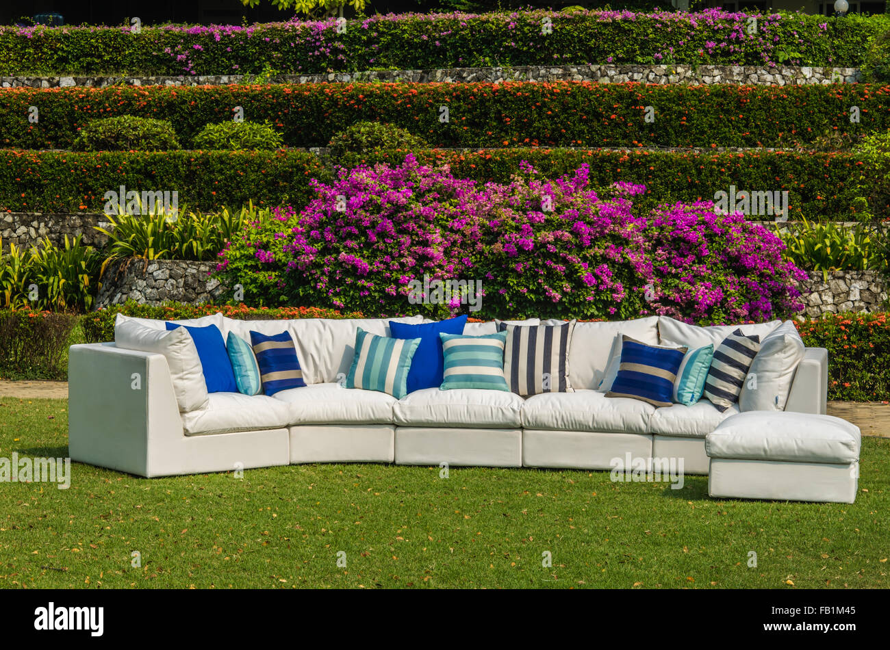 Outdoor furniture with cushions and pillows in the garden stock image
