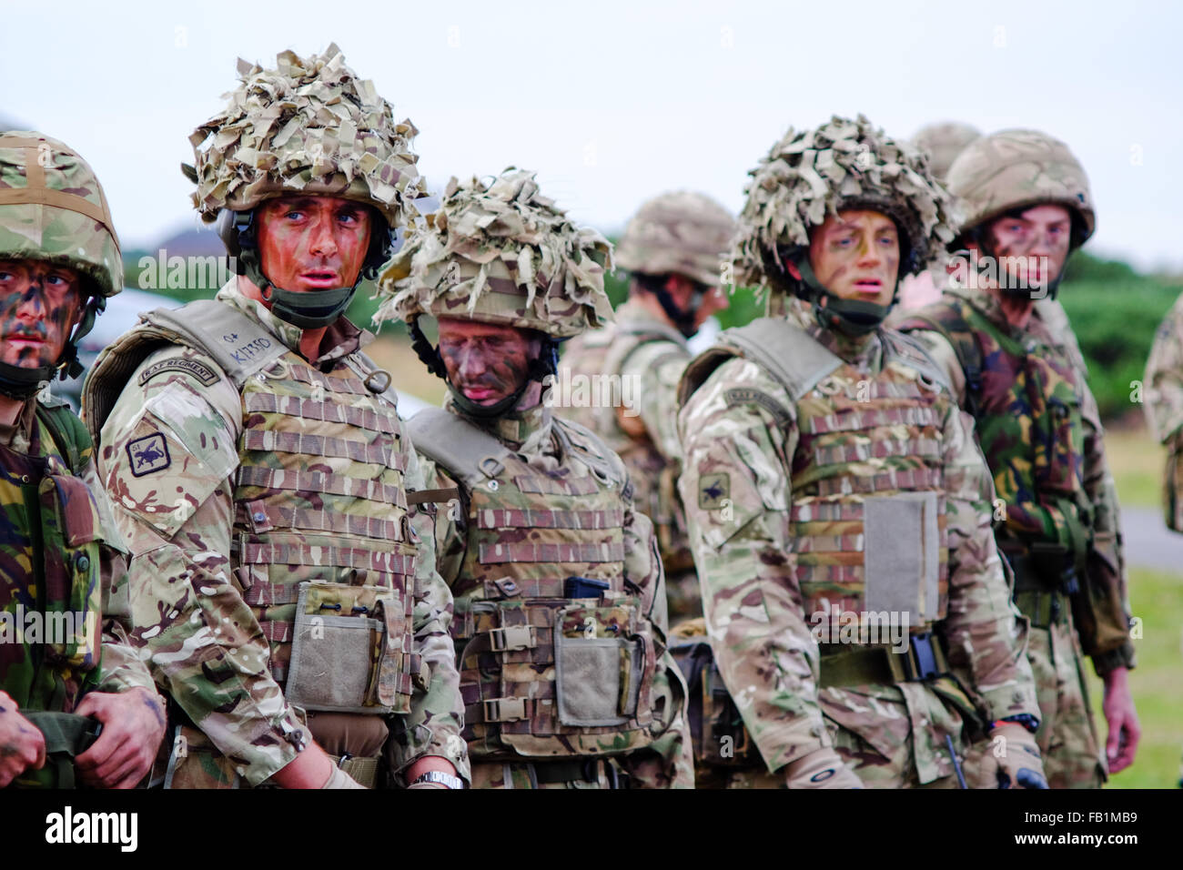 Royal Air Force RAF regiment soldiers line up in their camouflage flack jackets before a training exercise. - Stock Image