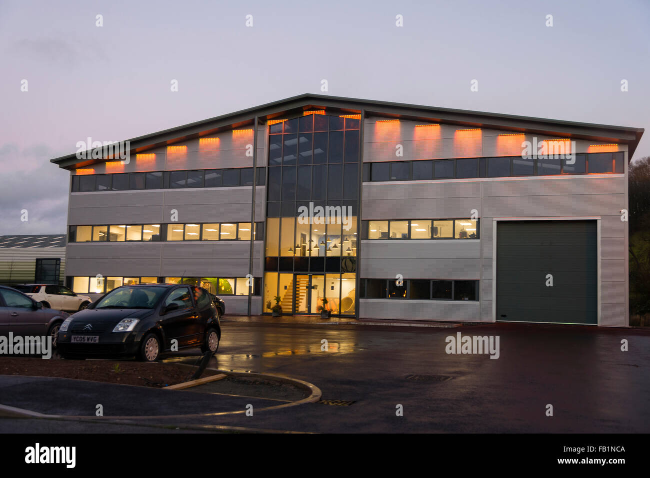 Commercial real estate industrial unit exterior taken at dusk, UK. - Stock Image