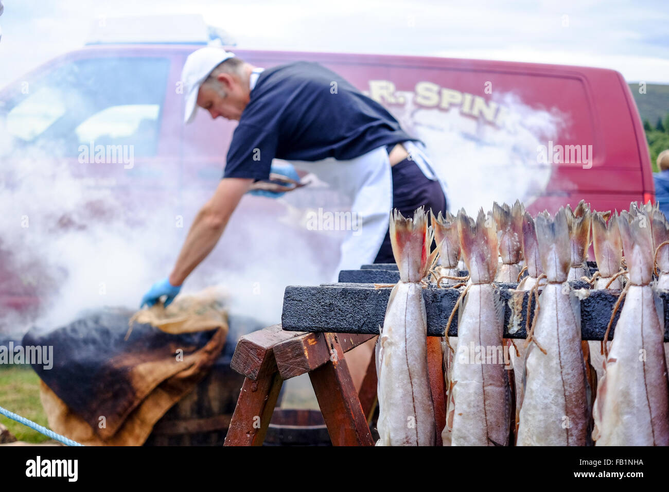 Ian R. Spink cooking Arbroath Smokies at the Moy Highland Games in Scotland. - Stock Image