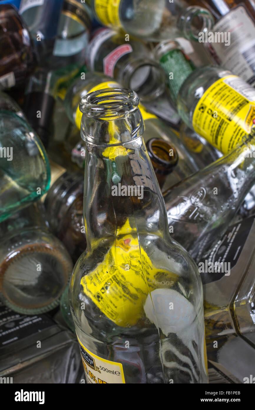 Batch of empty bottles in pub bottle bank. - Stock Image
