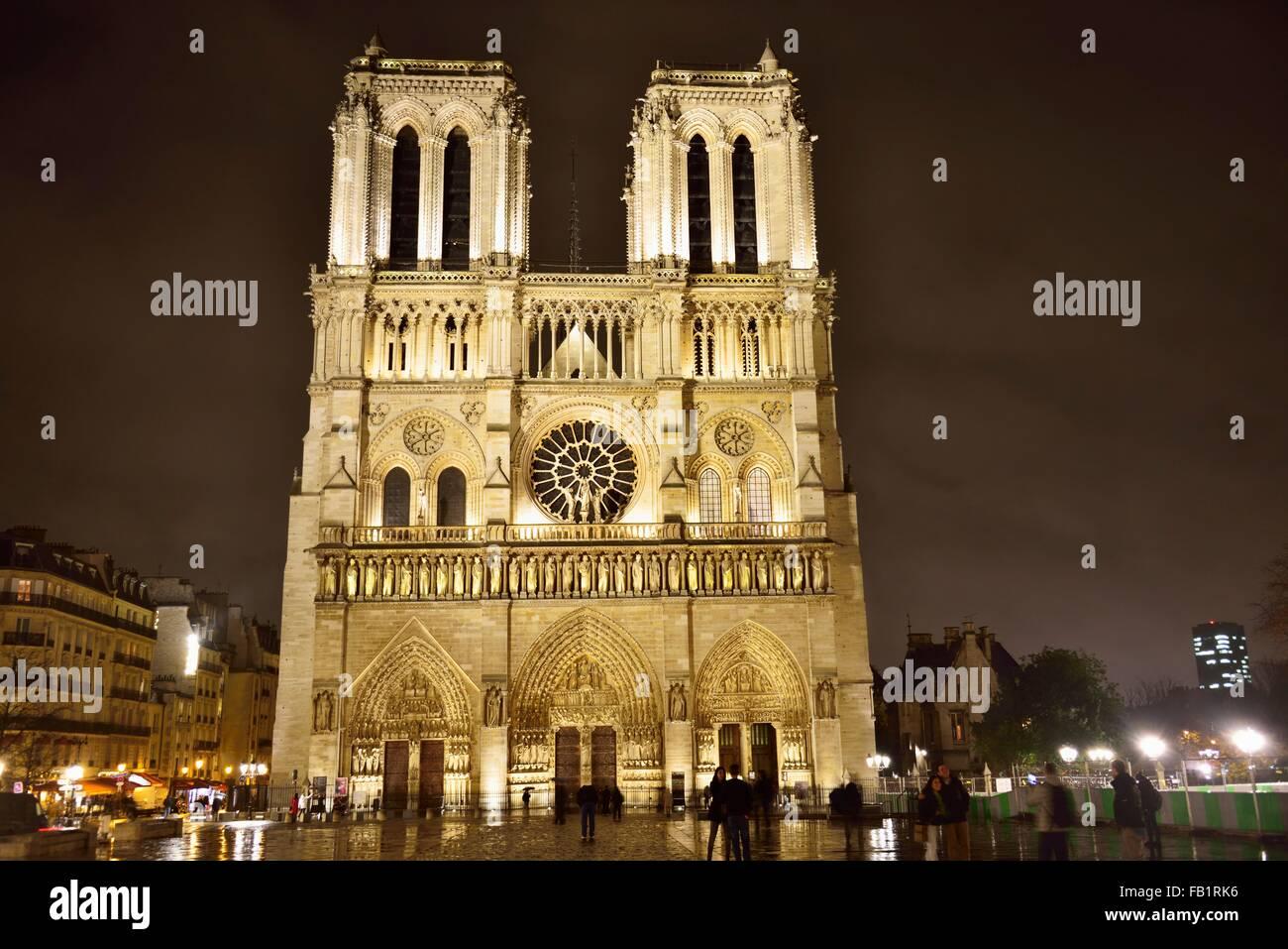 West Portal, Gothic cathedral Notre Dame de Paris at night, Ile da la Cite, Paris, Ile-de-Fance, France Stock Photo