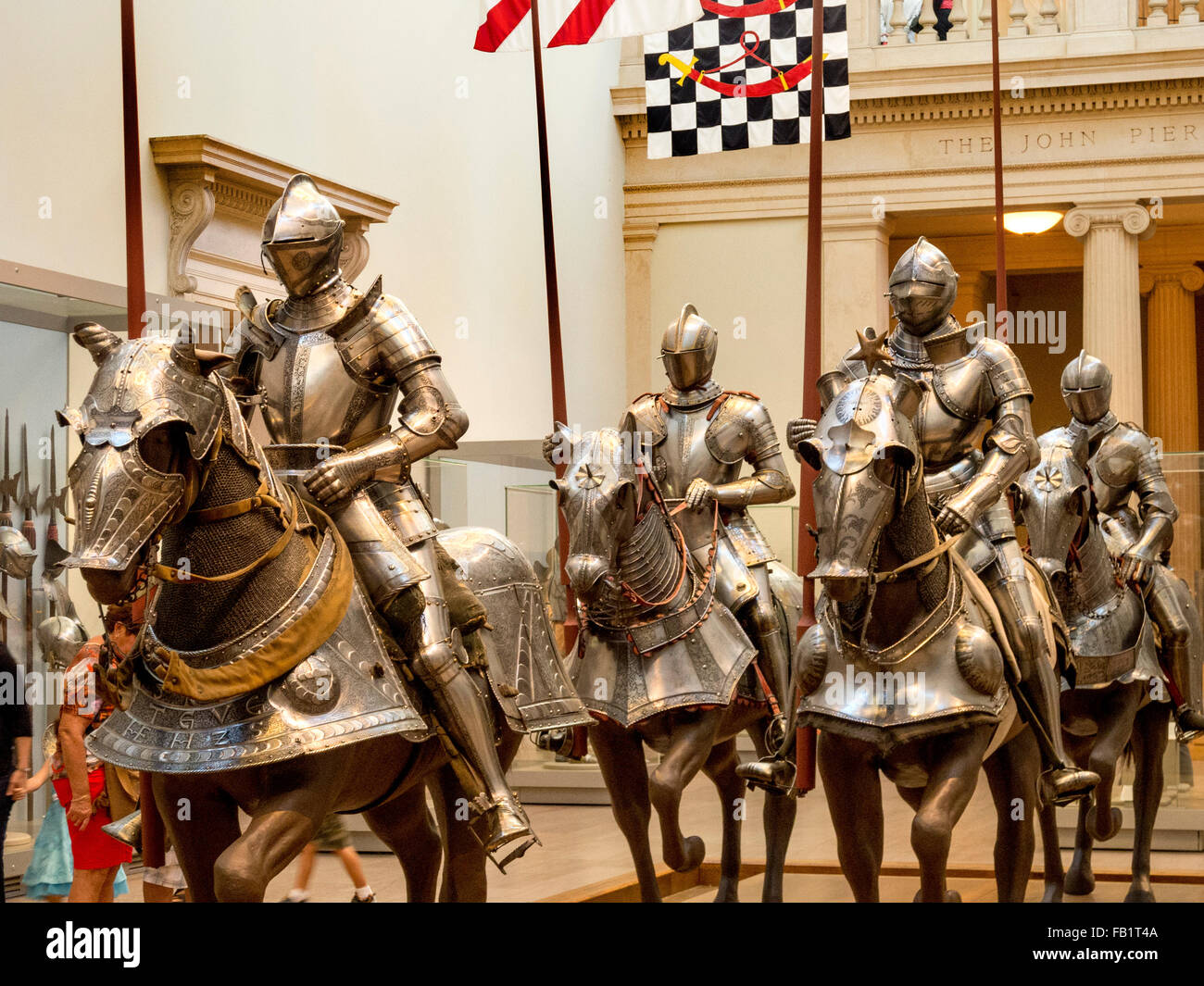 16th century medieval German full plate armor for man and horse at the Metropolitan Museum of Art, New York City. - Stock Image
