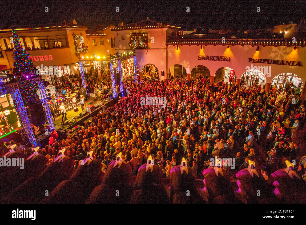 Framed By Roof Tiles, A Large Audience Attends A Night Time Christmas Rock U0027 Nu0027 Roll Concert At A San Clemente, CA, Shopping Mall. Note Christmas Tree  On ...