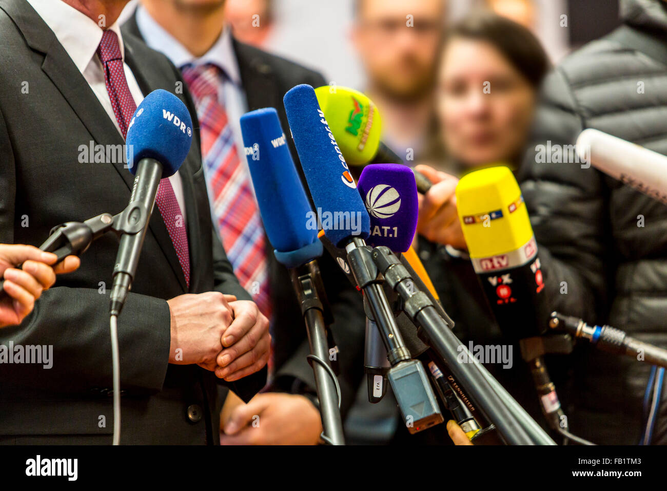 Microphones of different TV and radio stations during a press conference, media, - Stock Image
