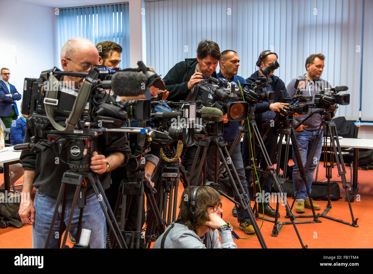 Camera teams of  different TV stations during a press conference, media, - Stock Image