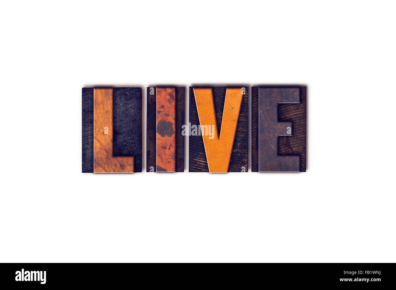 The word 'Live' written in isolated vintage wooden letterpress type on a white background. - Stock Image