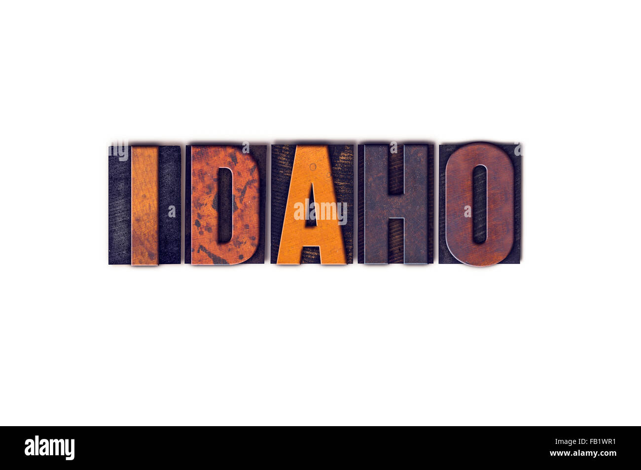 The word 'Idaho' written in isolated vintage wooden letterpress type on a white background. - Stock Image