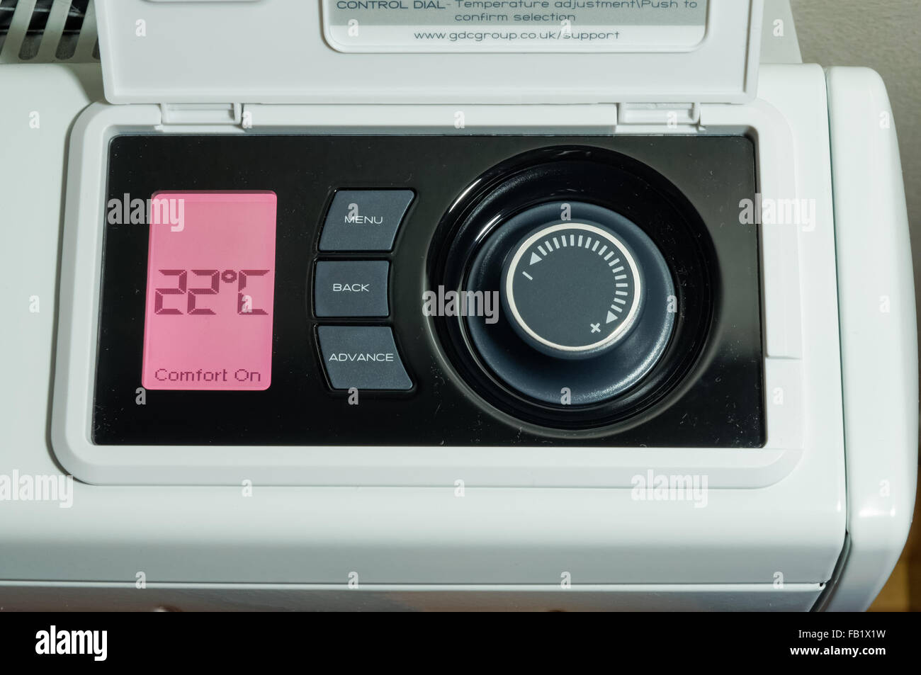 LCD display and temperature control panel on electric storage heater - Stock Image