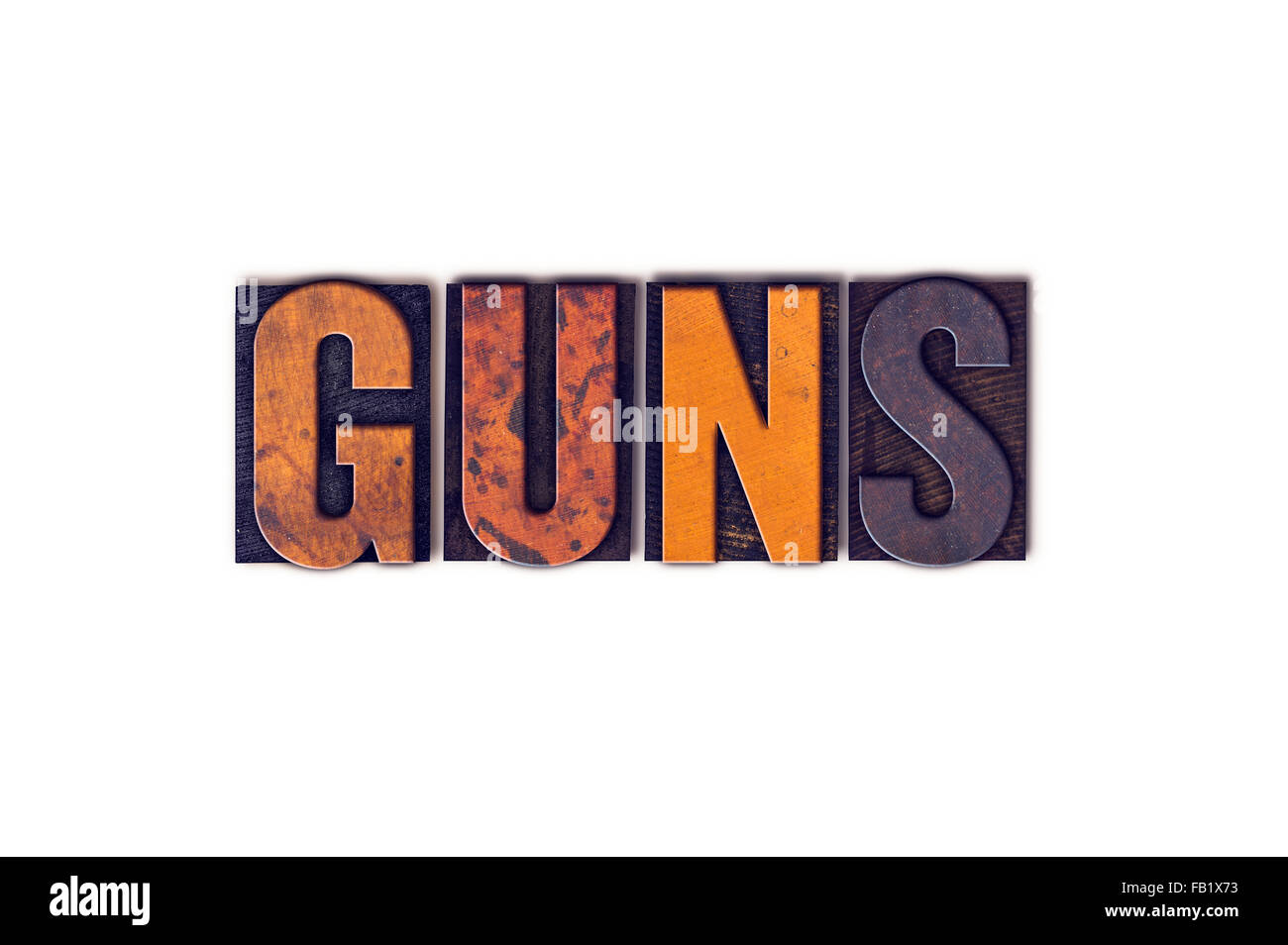 The word 'Guns' written in isolated vintage wooden letterpress type on a white background. - Stock Image