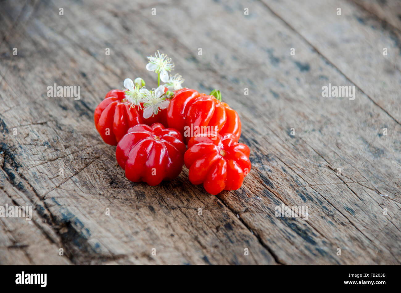 Tropical fruit called Pitanga, Brazilian cherry,Suriname cherry,Cayenne cherry.Shallow depth of field. - Stock Image