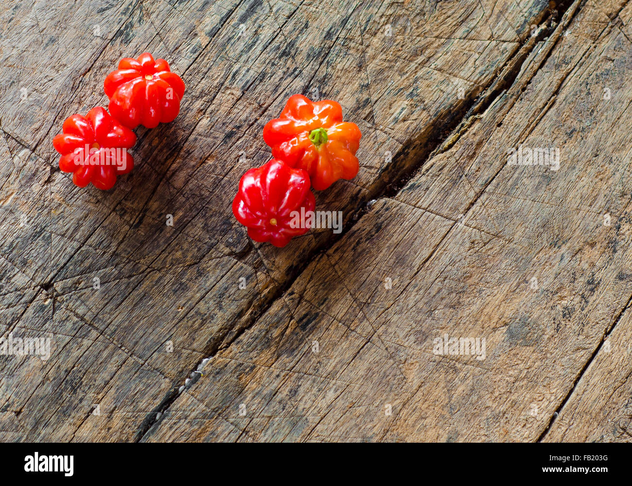Tropical fruit called Pitanga, Brazilian cherry,Suriname cherry,Cayenne cherry.Shallow depth of field. - Stock Image