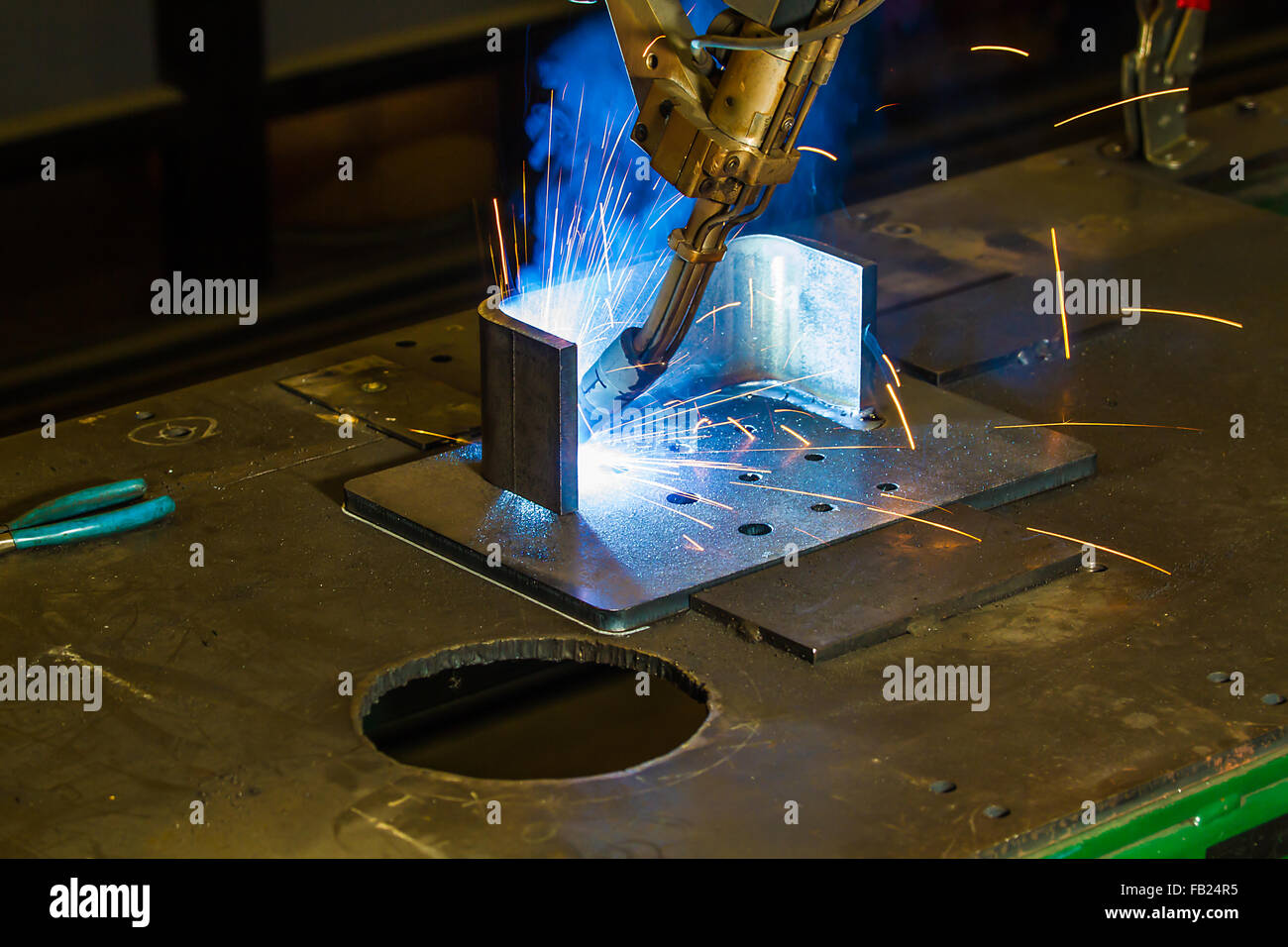 Mig Welding Stock Photos Images Alamy Welder Parts Flux Cored With Cnc Robotic Of Half Inch Steel Sparks Shooting Up Clamp And