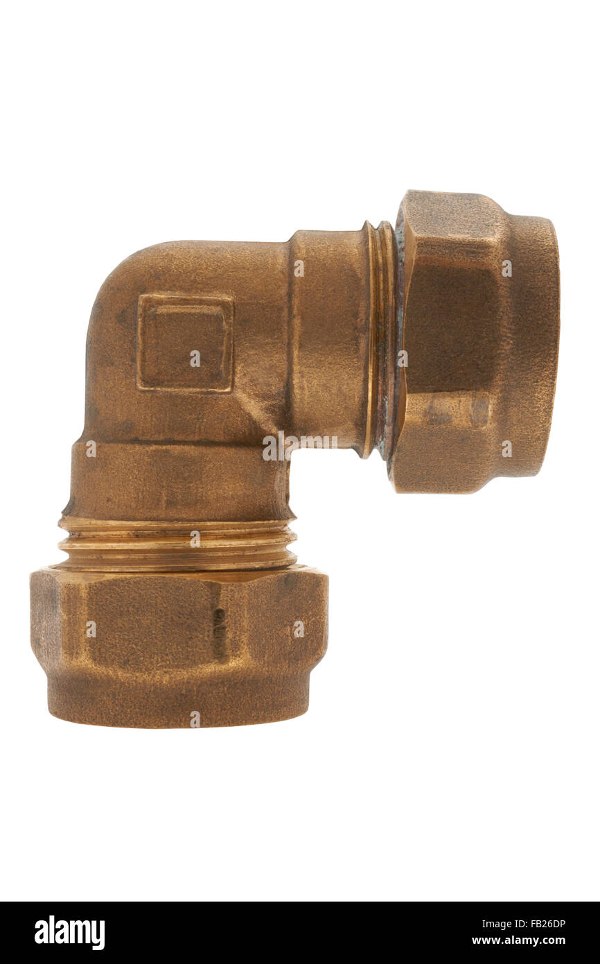 Brass elbow compression fitting on white background - Stock Image