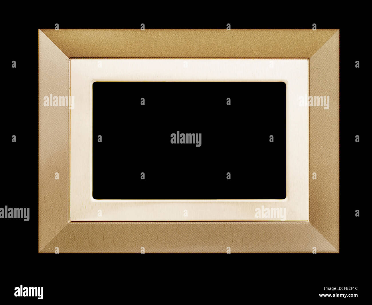 Rectangular, unbranded gold picture frame isolated on black - Stock Image