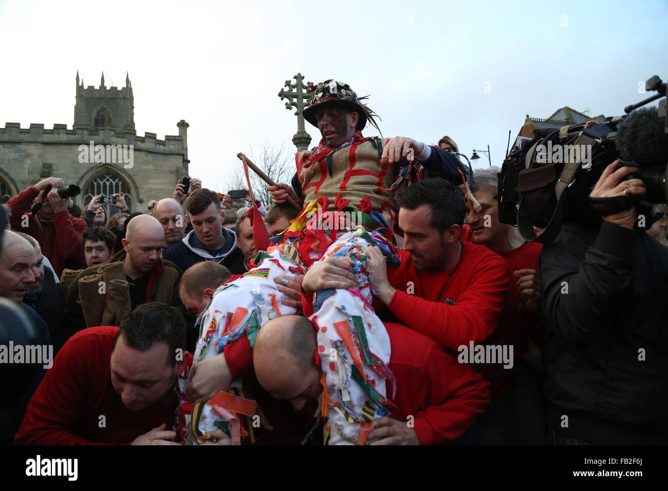 The fool is carried to the mounting block ready to make his speech and then be 'smoked' before the start of the Stock Photo
