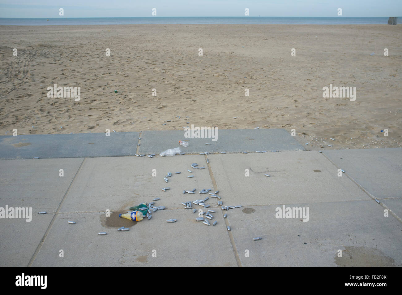 Laughing gas (nitrous oxide) canisters at the seaside - Stock Image