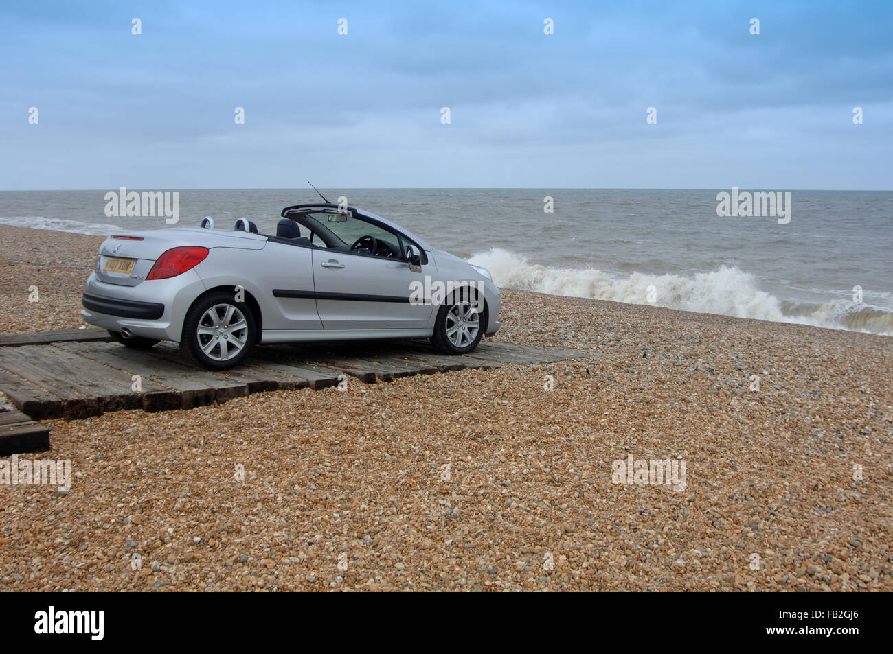 Peugeot 206 CC (Coupe Convertible) open top car with folding metal roof - Stock Image