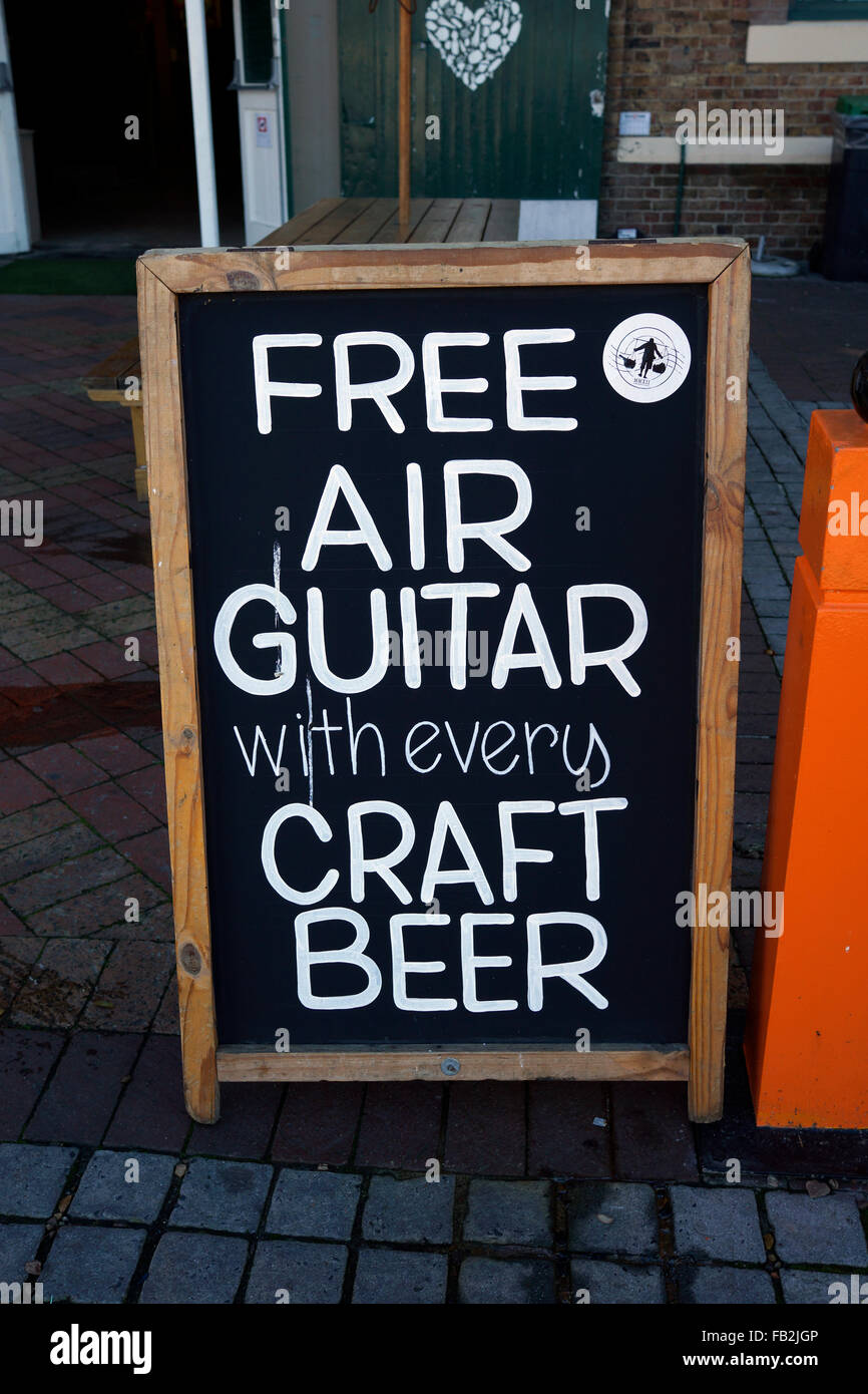 Humerous sign out side pub in Cape Town, South Africa. - Stock Image