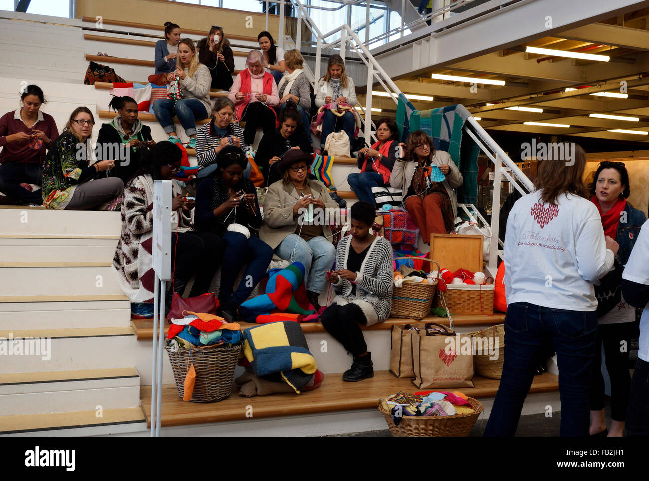 a group of south africans making blankets for the 67 blankets for