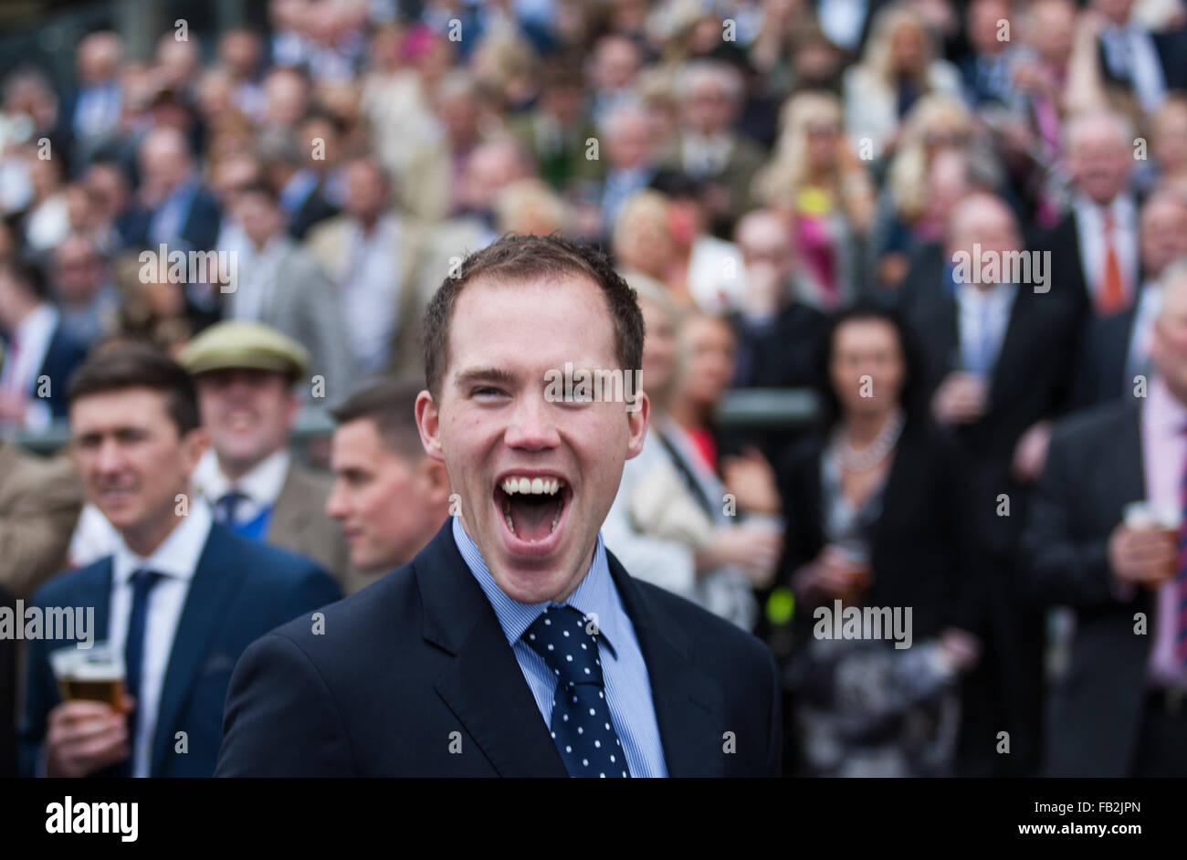 A racegoer celebrates his horse winning at the 2014 Grand National at Aintree in Liverpool, UK. Stock Photo
