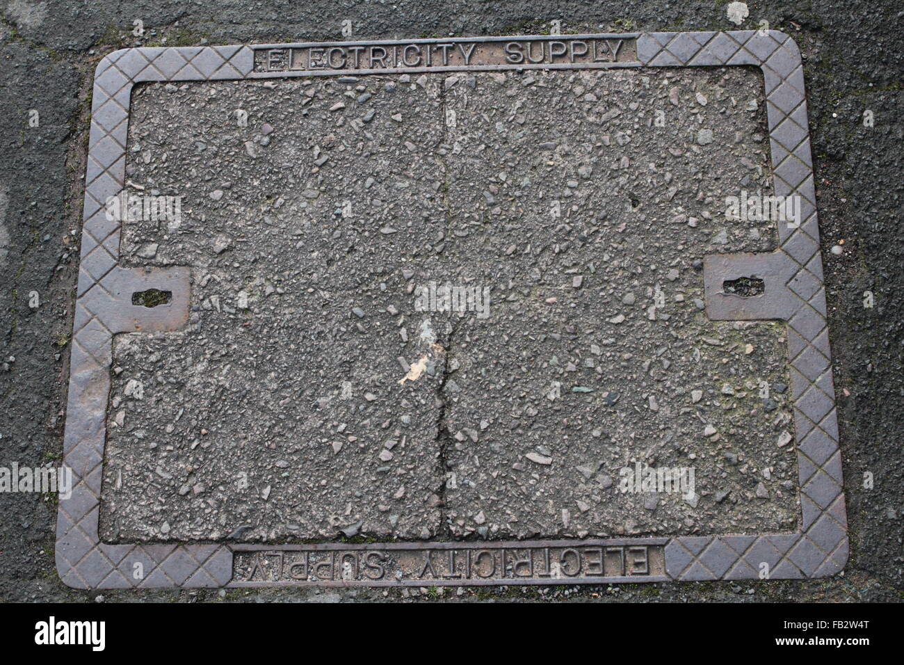 outdoor electricity utility company access cover - Stock Image