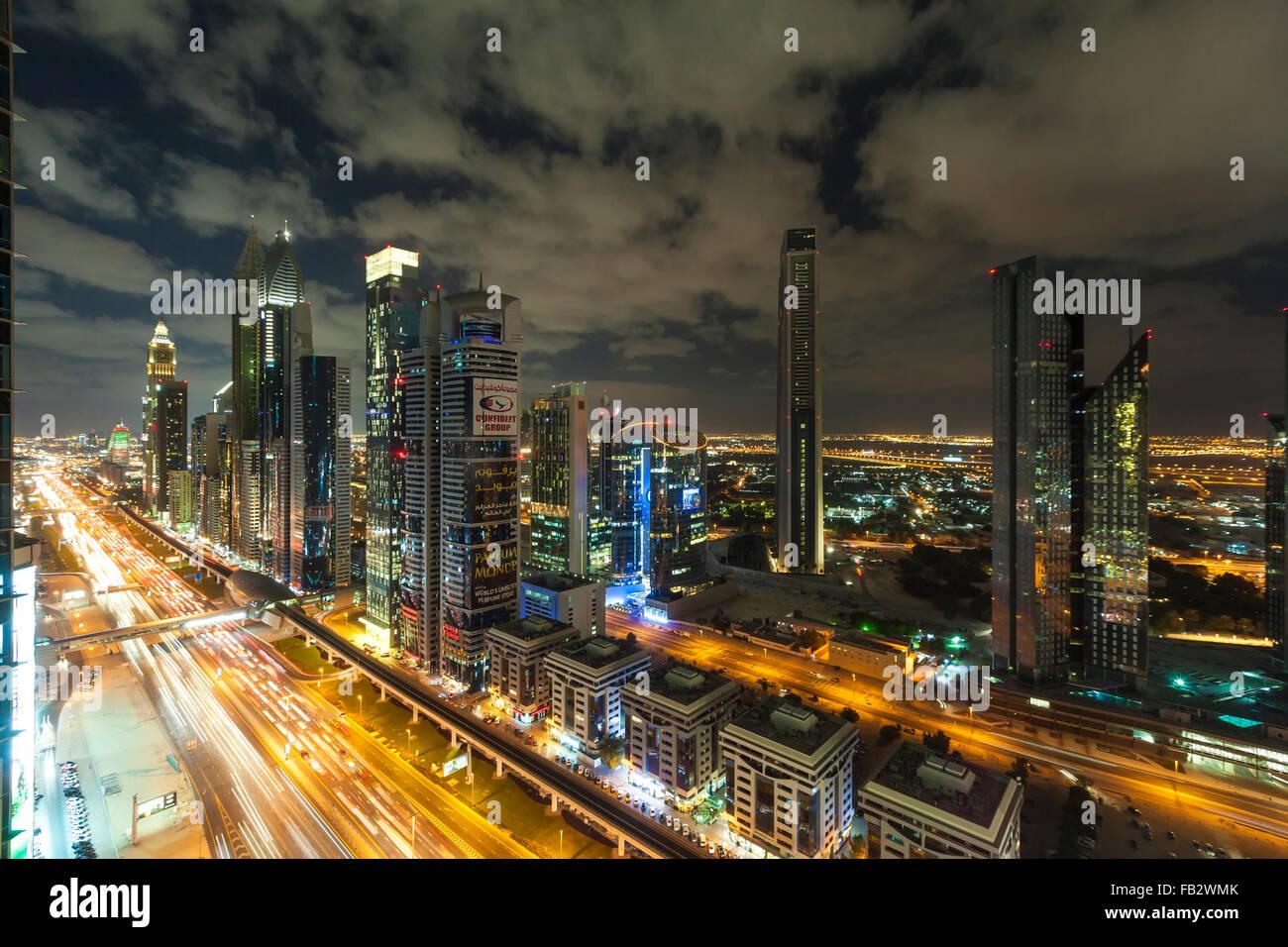 United Arab Emirates, Dubai, Sheikh Zayed Rd, traffic and new high rise buildings along Dubai's main road - Stock Image