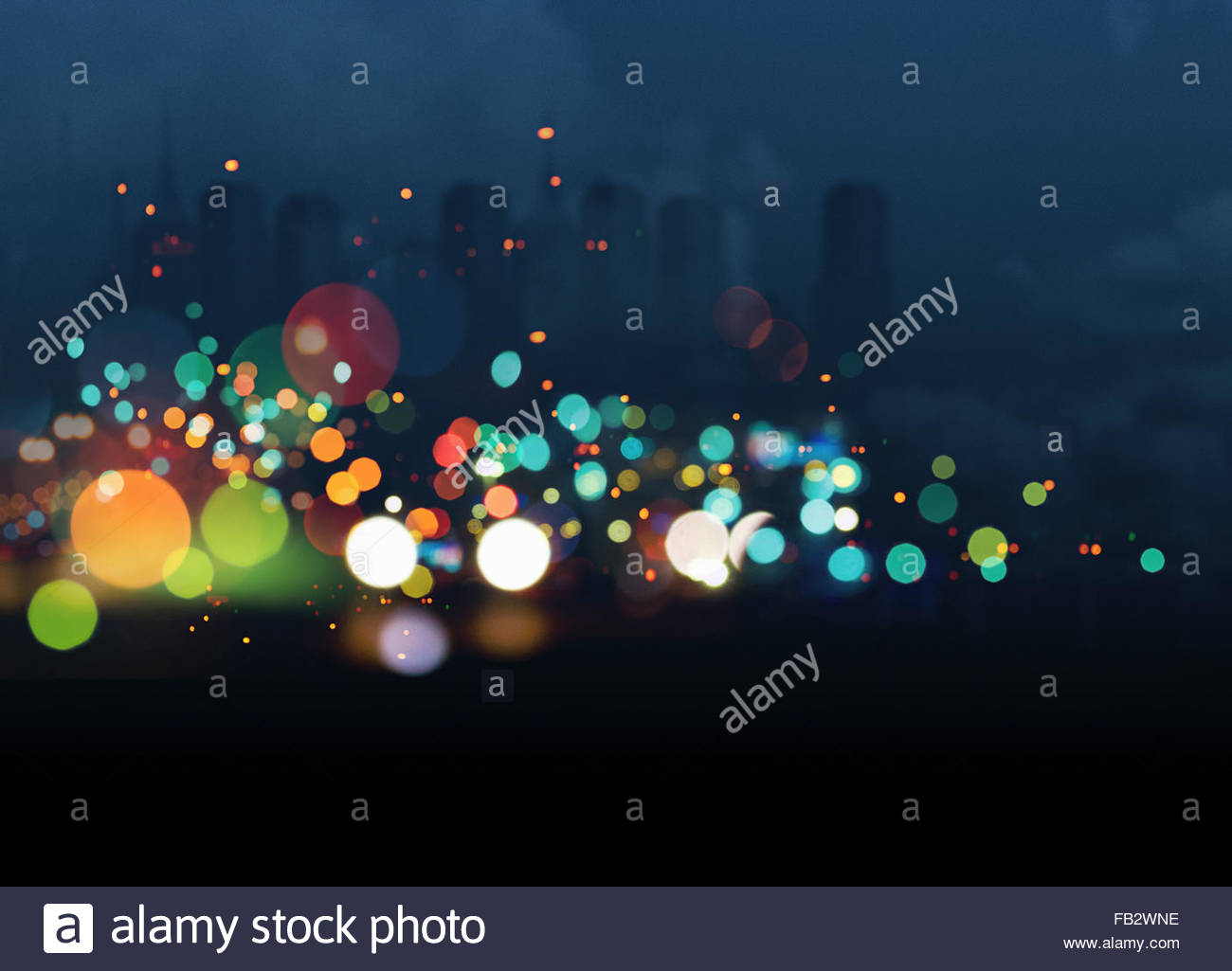 Abstract bright multicolored lights against city skyline - Stock Image