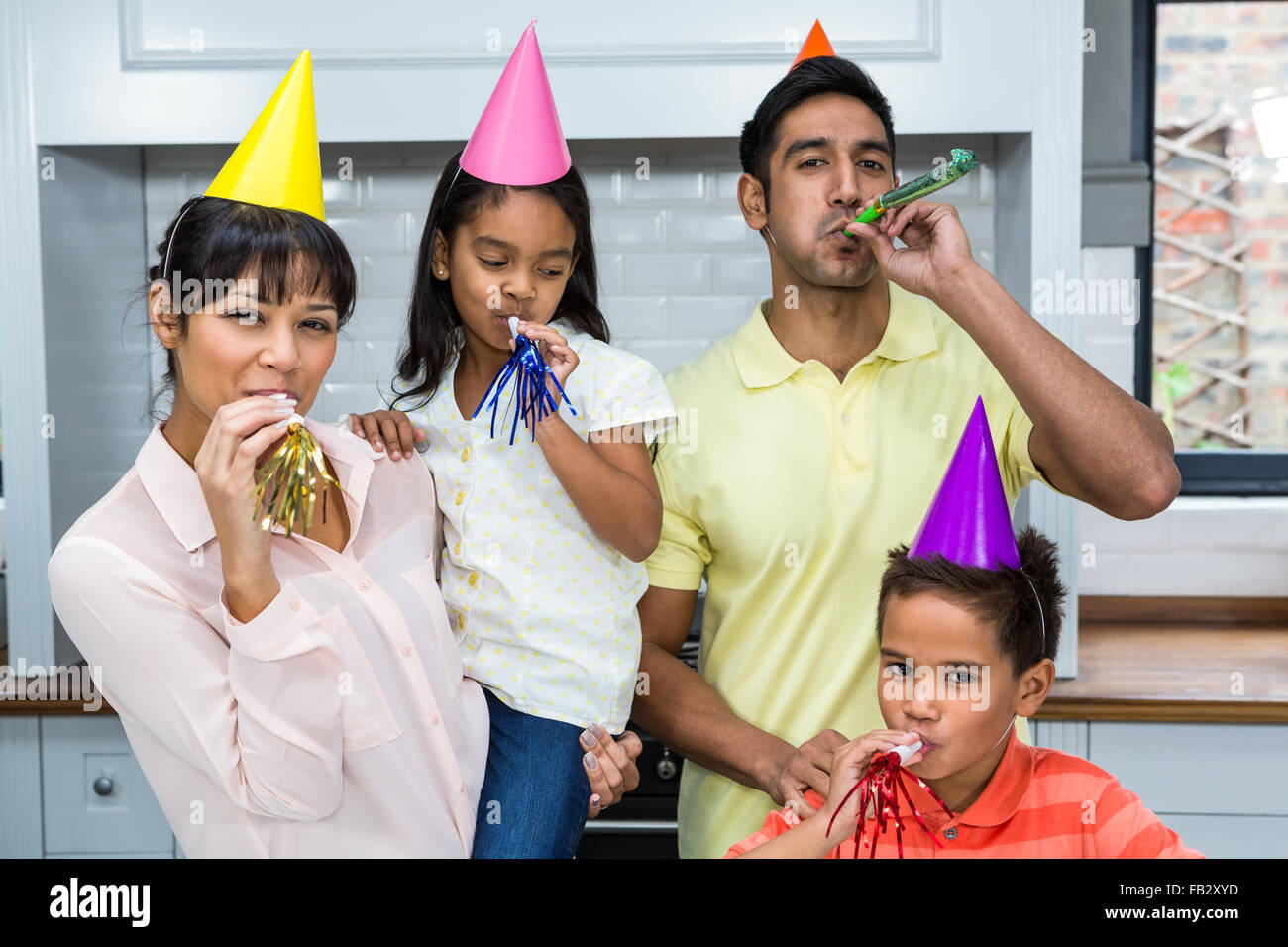 Happy family partying in the kitchen - Stock Image