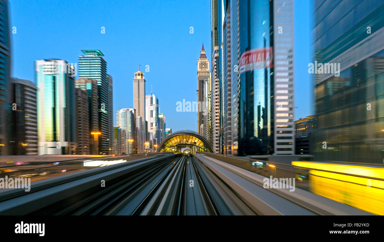 POV on the modern driverless Dubai elevated Rail Metro System, running alongside the Sheikh Zayed Rd, Dubai, UAE - Stock Image