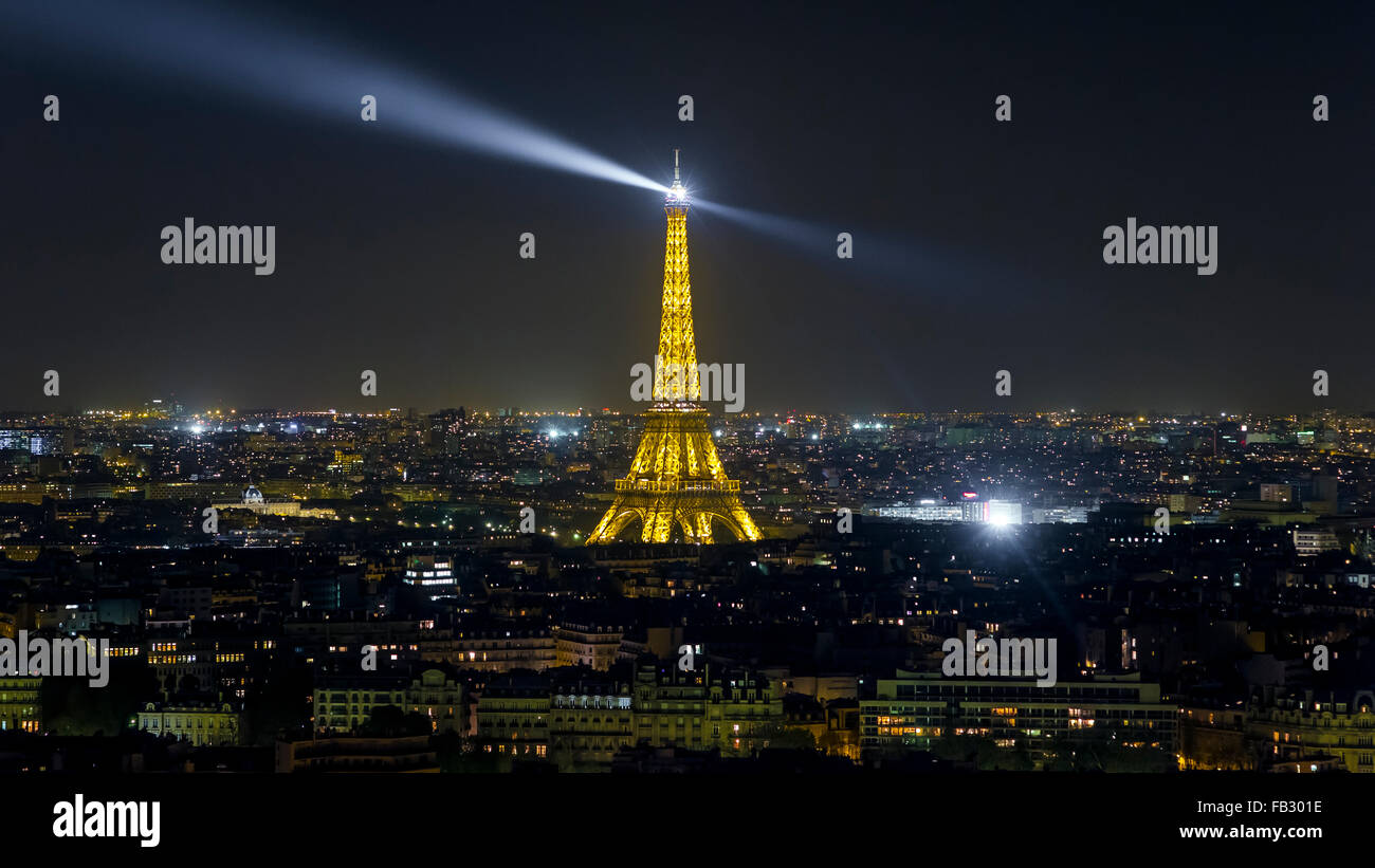 Paris elevated night city skyline with illuminated Eiffel tower, France, Europe - Stock Image