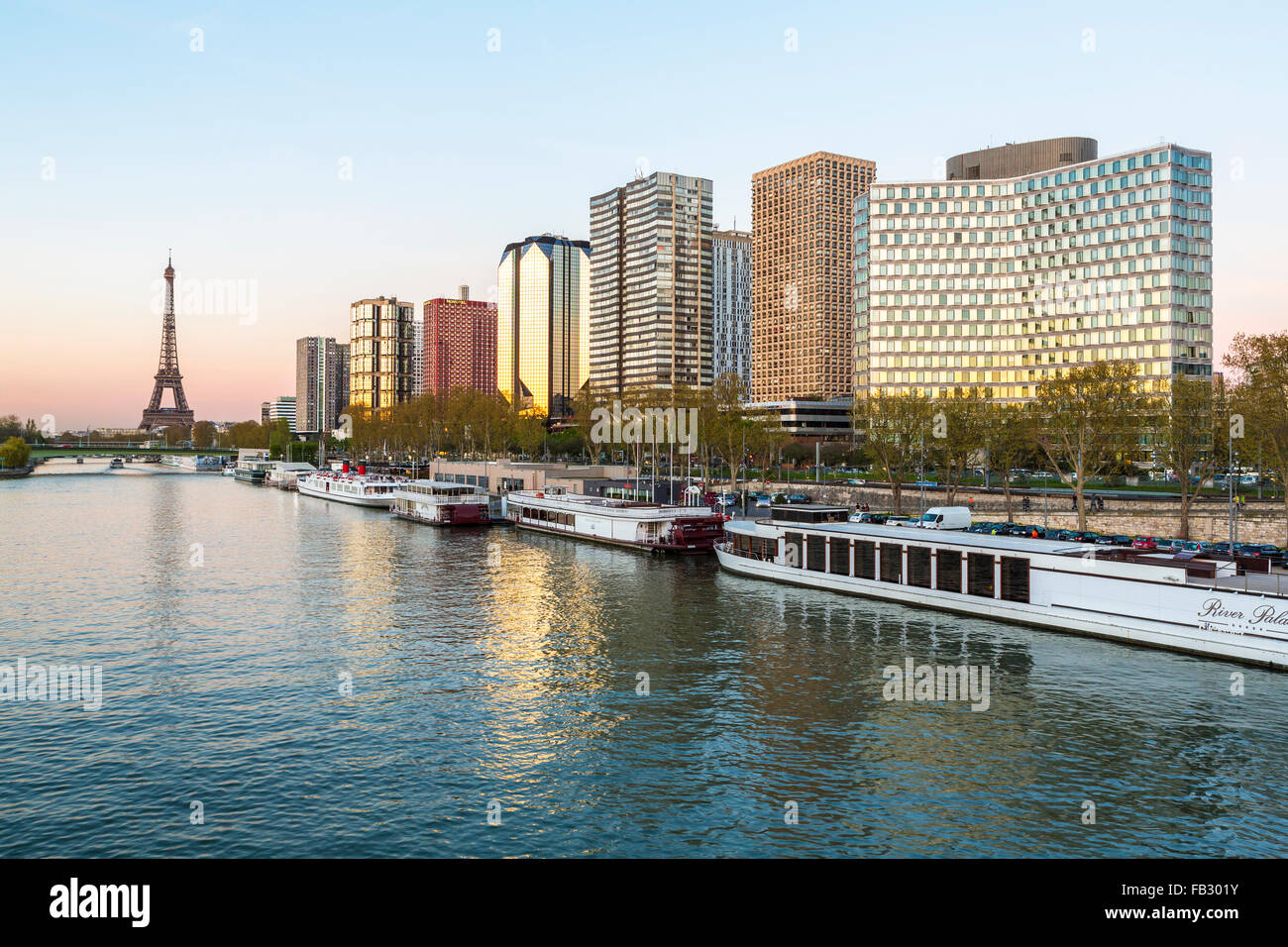 Evening view of River Seine with high-rise buildings on the Left Bank, and Eiffel Tower, Paris, France, Europe - Stock Image