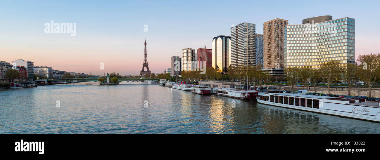 Panoramic view of Eiffel Tower and River Seine with boats and high-rise buildings on the Left Bank, Paris, France, - Stock Image